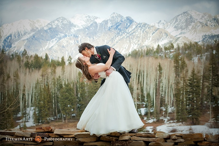 romantic picture of a new bride and groom with the snow capped mountains in the background